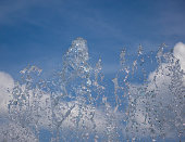 Water spray against the sky in the sunlight