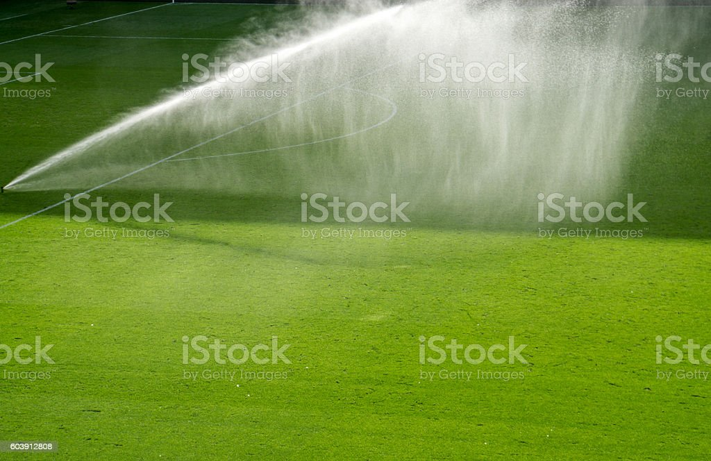 Water spraying on football pitch stock photo
