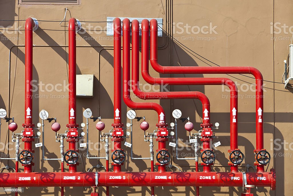 water sprinkler fire fighting alarm system, red pipe stock photo