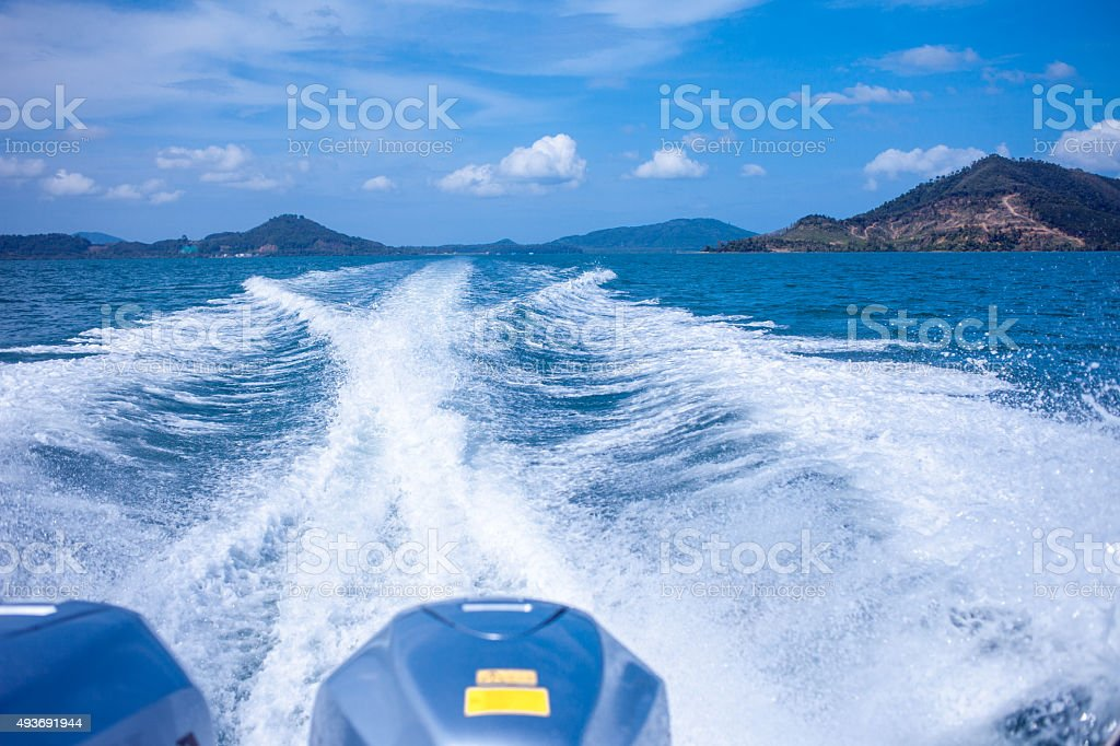 Water stream after speed boat. Summer landscape, a warm Sunny stock photo