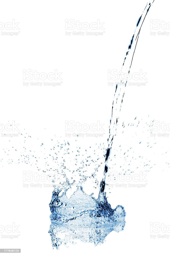 Water stream making a splash when reaching surface stock photo