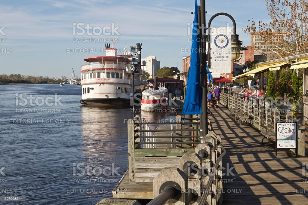 Water Street Boardwalk and Tour Boat in Wilmington, NC stock photo