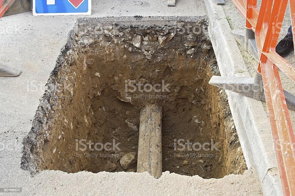 Water Supply Repairs - Hole In Road With Pipe stock photo