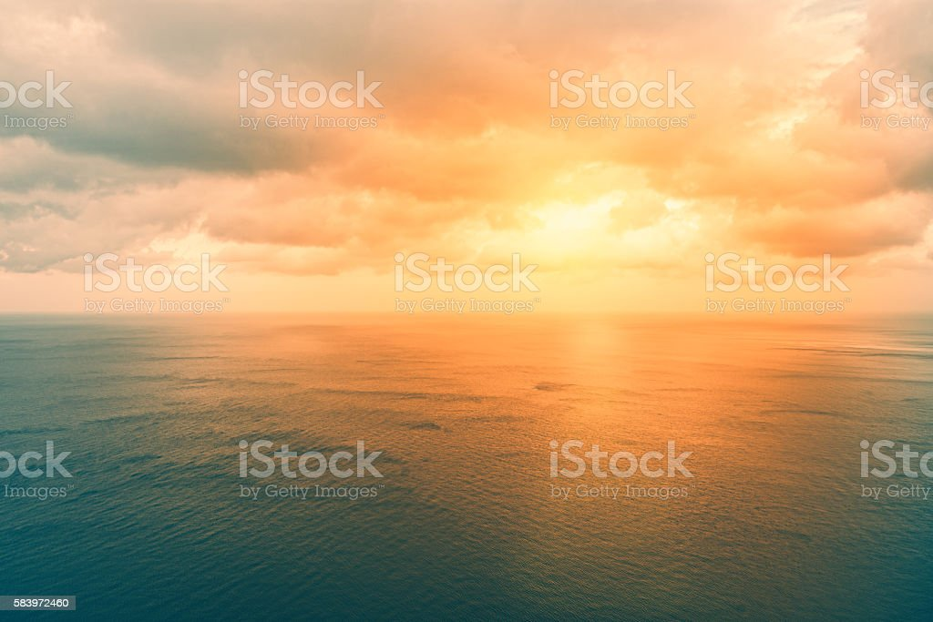 water surface from above - horizon over orange ocean stock photo
