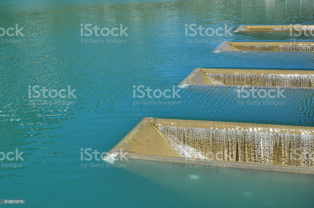Water surface with fillers by artificial pouring stock photo