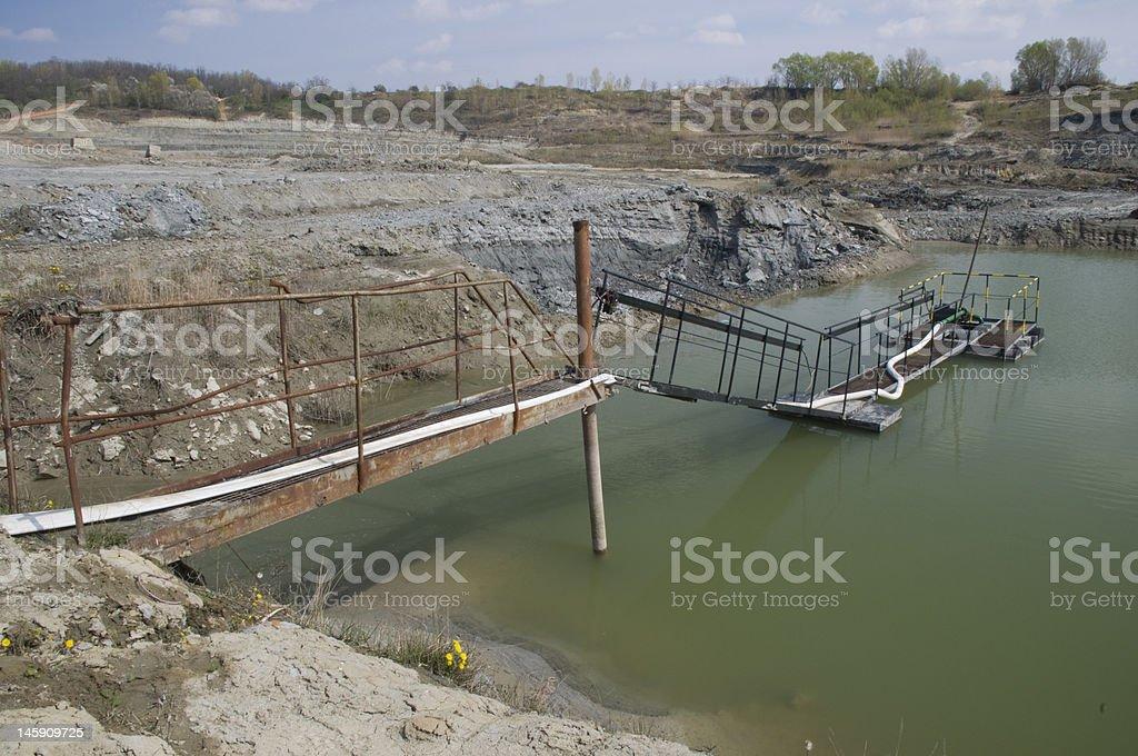 Water tank in the huge opencast mine stock photo