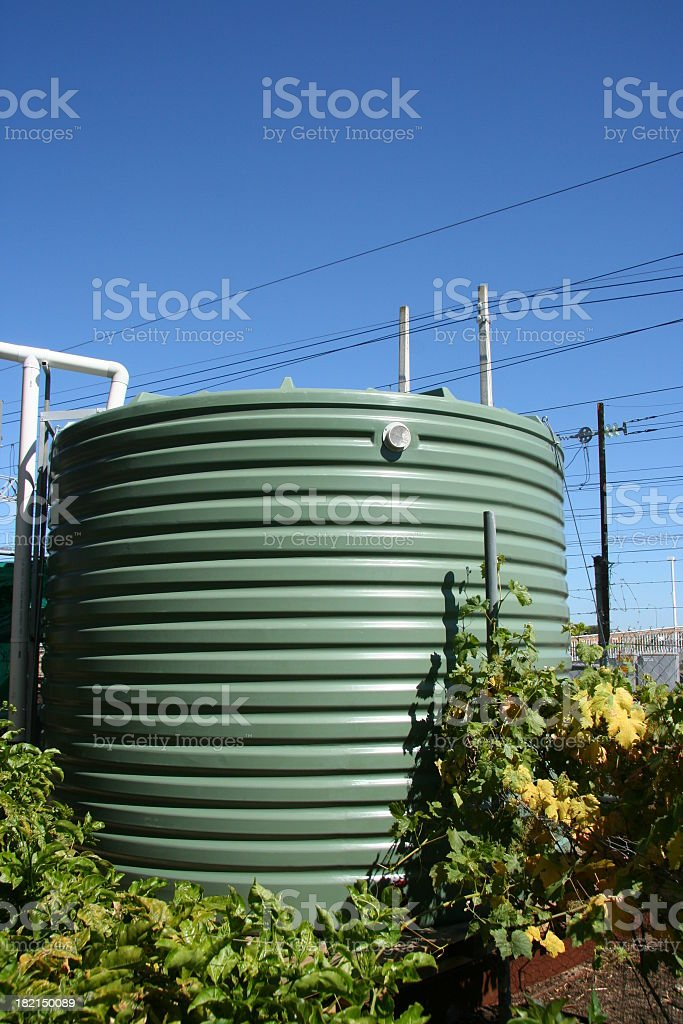 A water tank surrounded by a floral vine stock photo