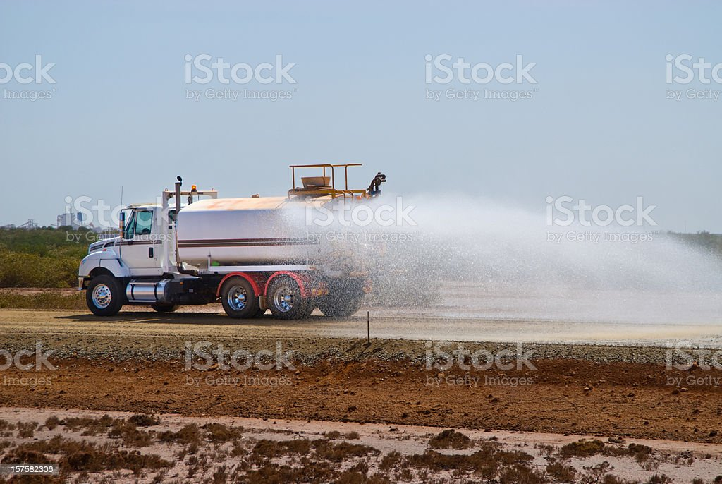 water tanker / truck dust suppression on construction site royalty-free stock photo