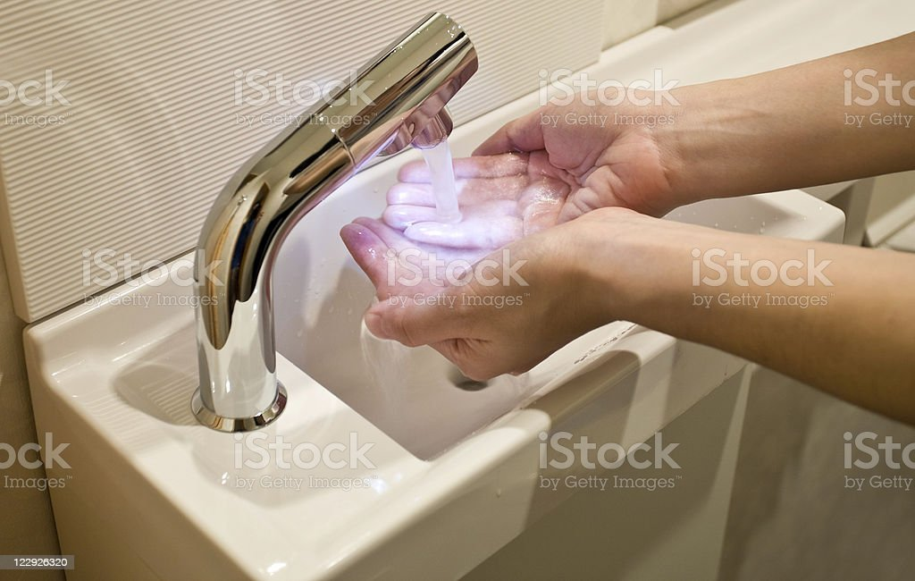 LED water tap and tiny sink royalty-free stock photo