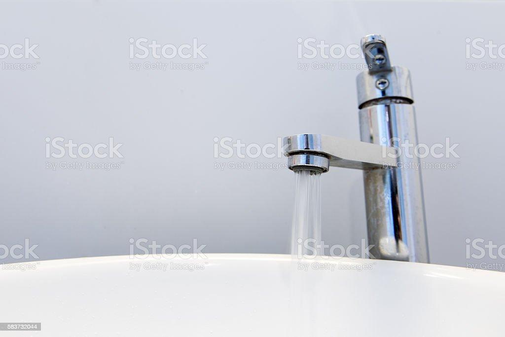 Water tap running stock photo