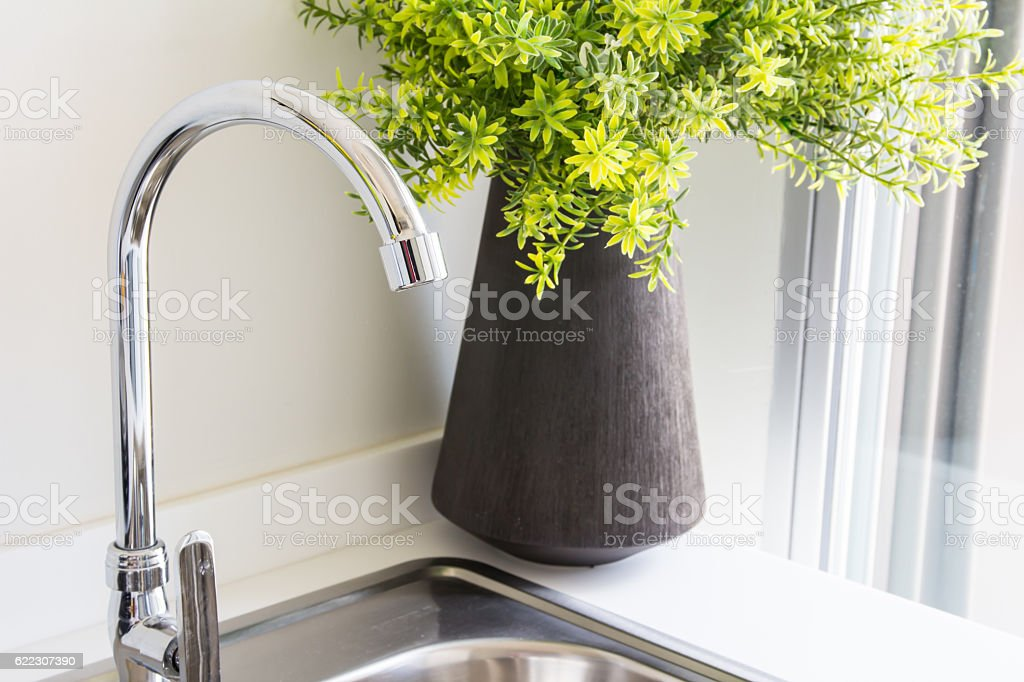 Water tap with sink stock photo