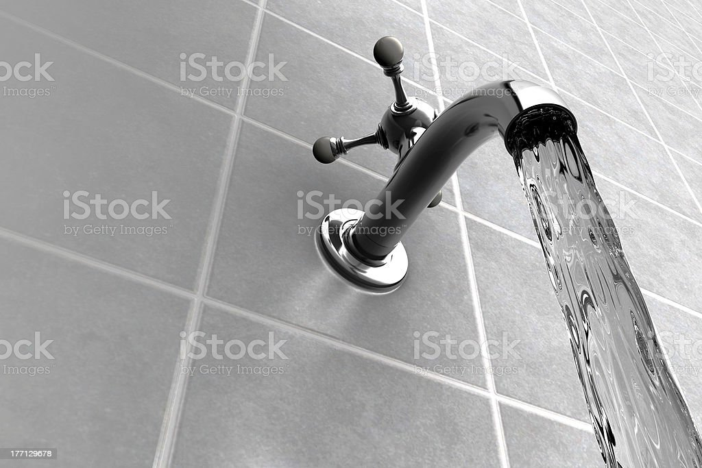 Water tap with tiles stock photo