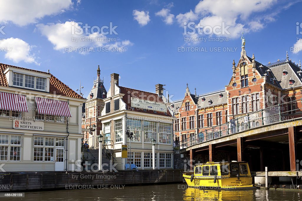 Water Taxi moored next to Amsterdam Centraal Railway Station. stock photo