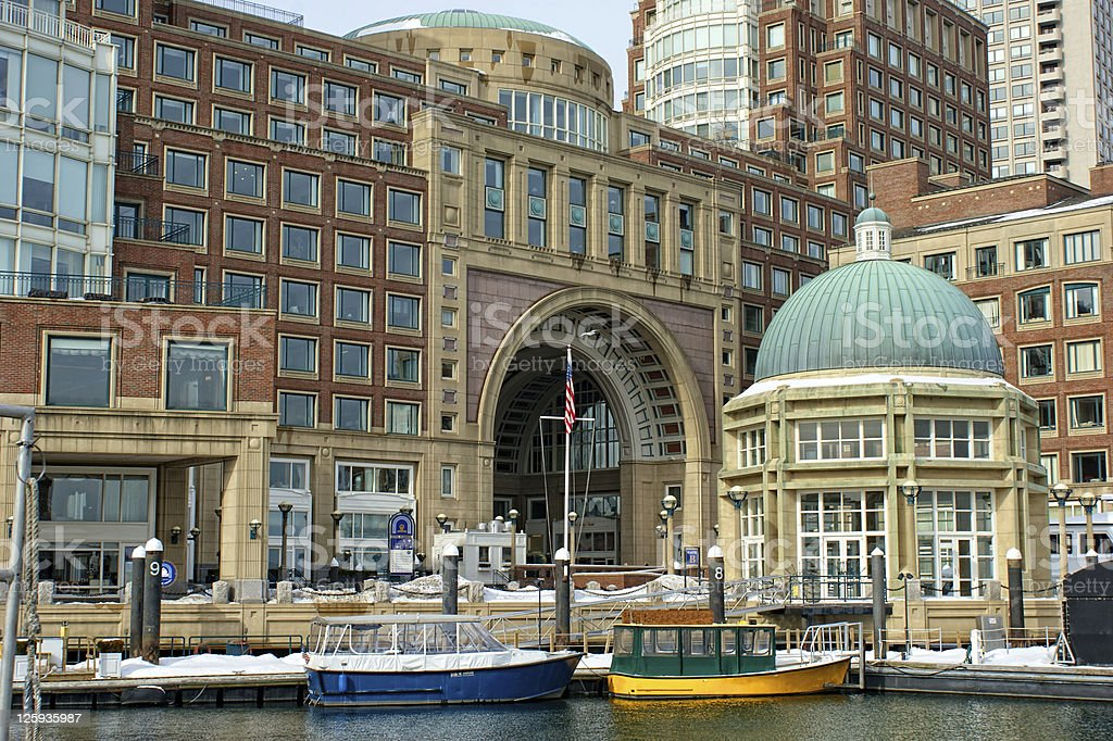 water taxis inside historic rowes wharf boston massachusetts in winter stock photo