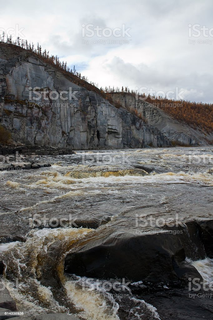 Water threshold on the Siberian taiga river in the fall stock photo