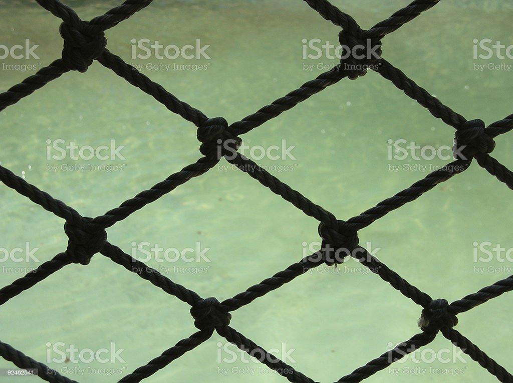 Water through rope net royalty-free stock photo