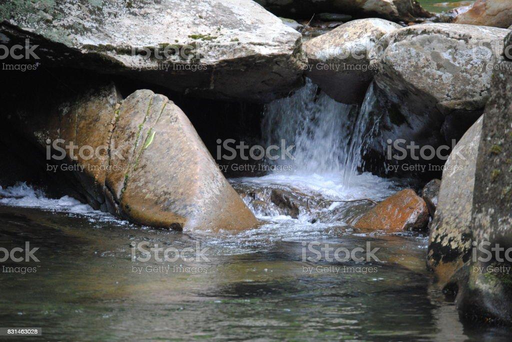 Water Through the Rocks stock photo