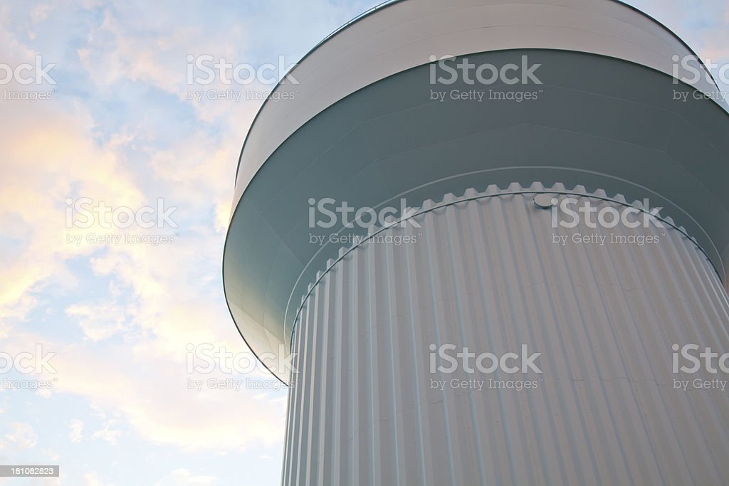 Water tower on a sunny sky with white clouds background stock photo