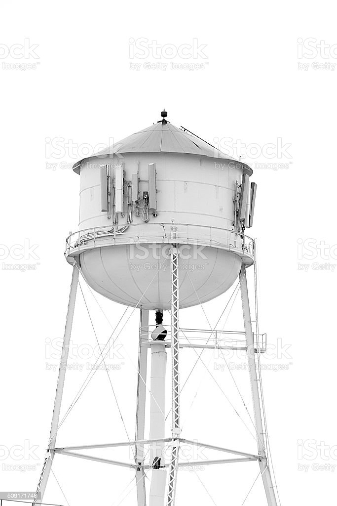 Water tower rises above to feed local water supply stock photo