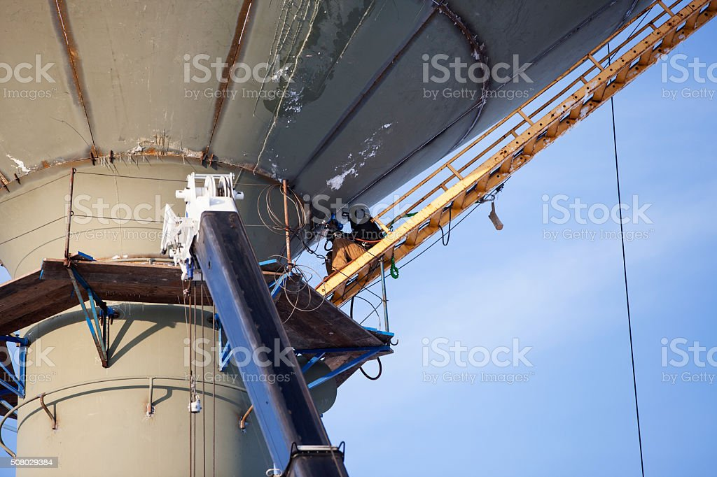 Water Tower Under Construction with Worker stock photo