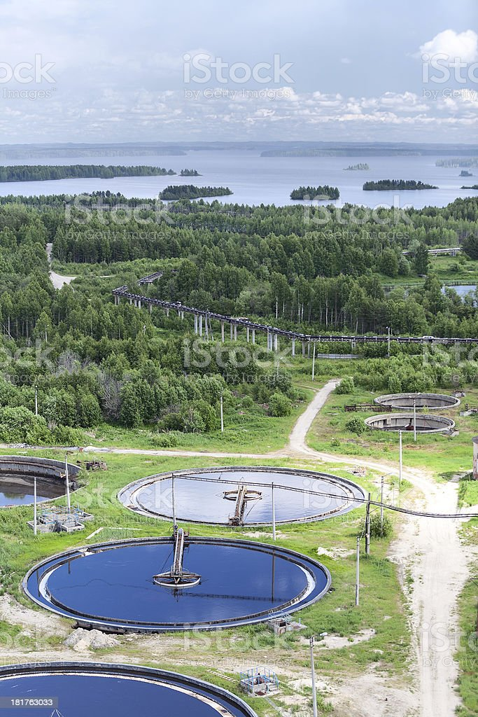 Water treatment plant in evergreen woods and blue lakes royalty-free stock photo
