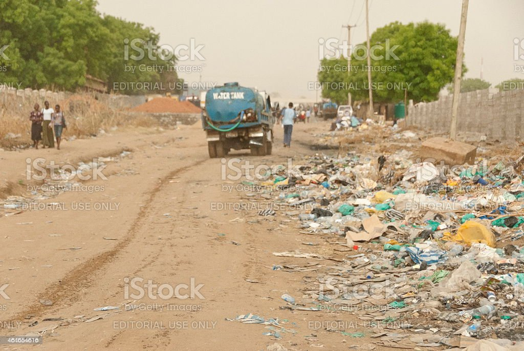 Water truck goes down the street in Juba, South Sudan. stock photo