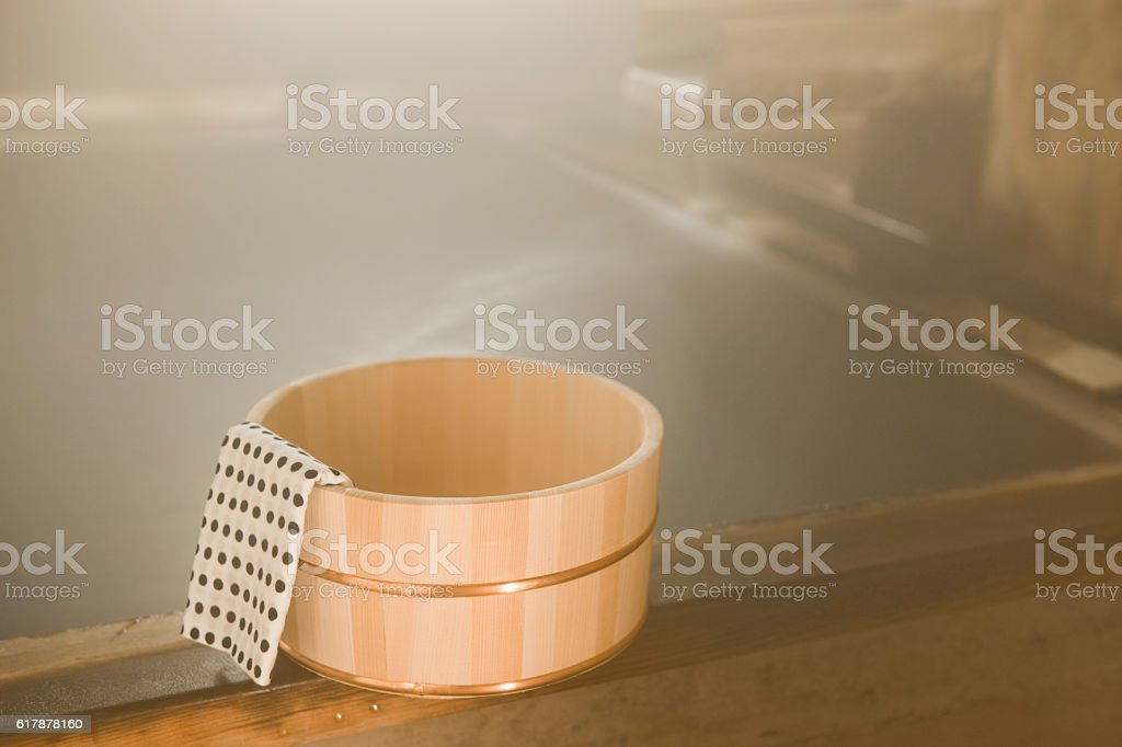 Water tub with Japanese towel in hot spring stock photo
