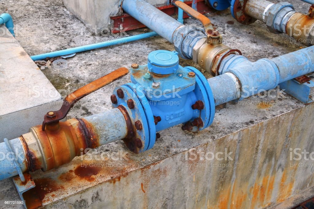 water valve plumbing joint  steel rust industrial old  tap pipe stock photo