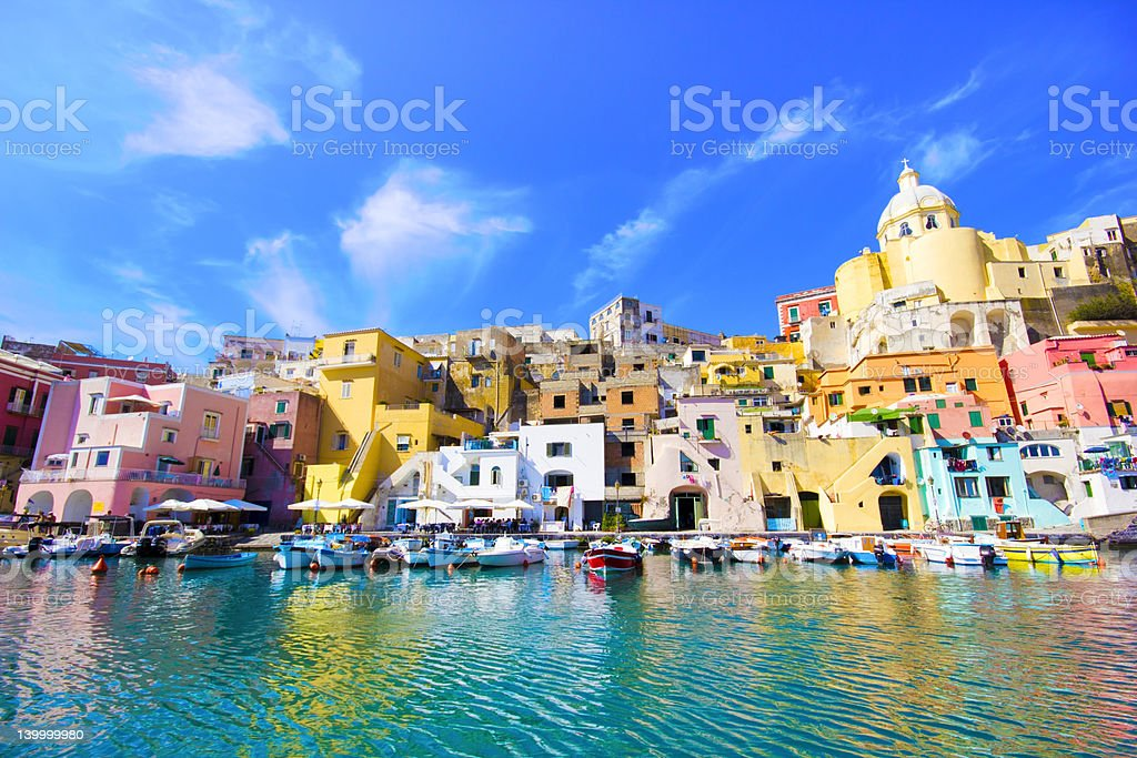 Water view of colorful Procida in Naples Italy stock photo