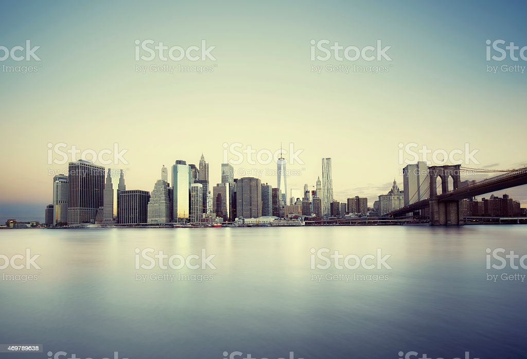 Water view of the cityscape of New York City at sunrise stock photo