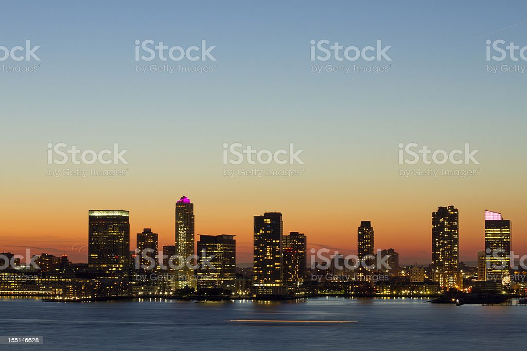 Water view of the Hoboken New Jersey skyline at dusk stock photo