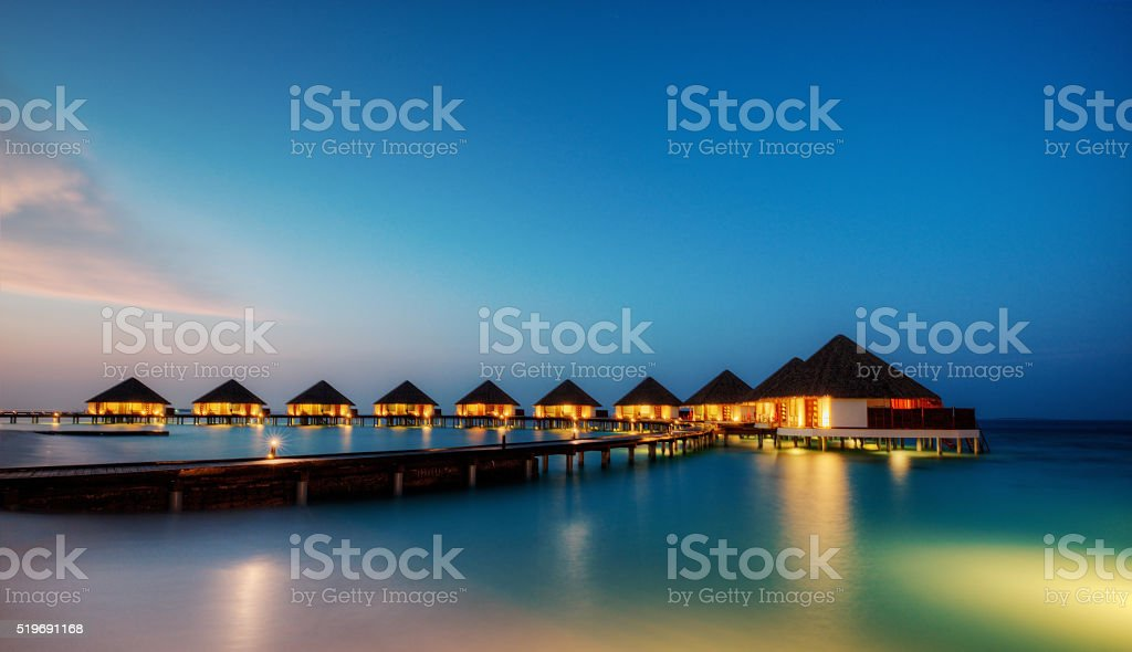 Water villas in hotel resort, Maldives stock photo