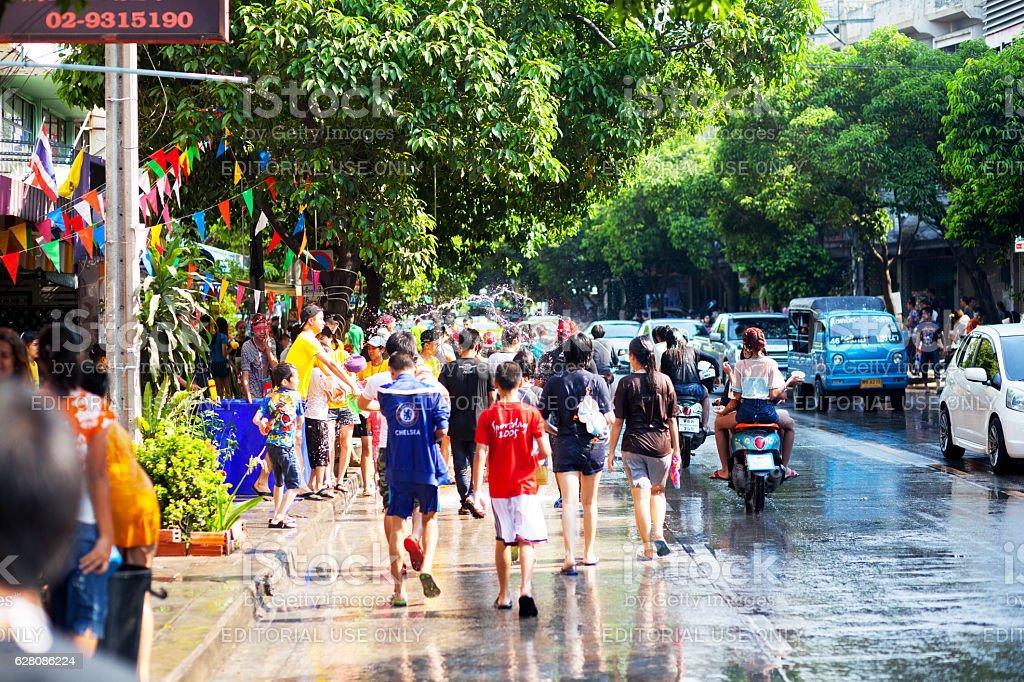 Water walking and fightig at Songkran stock photo