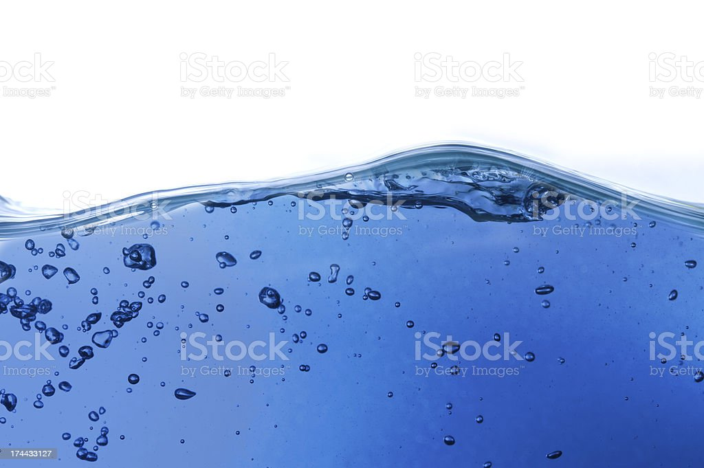 Water wave on blue background royalty-free stock photo