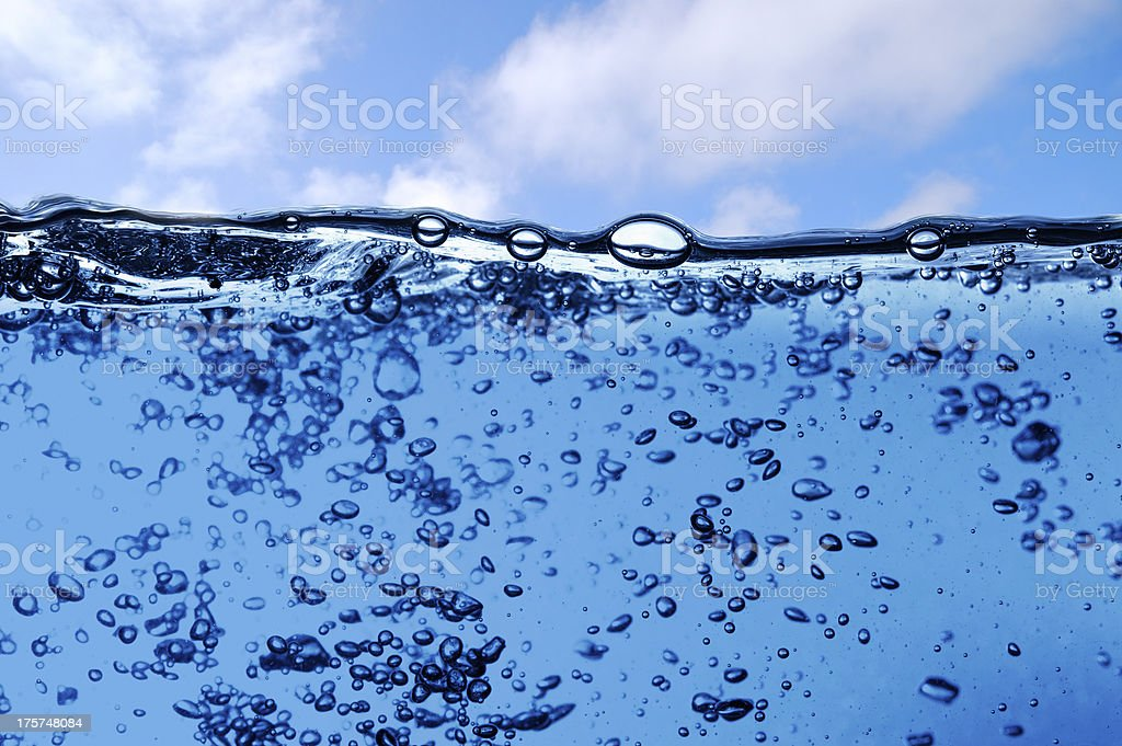 Water wave on sky background royalty-free stock photo