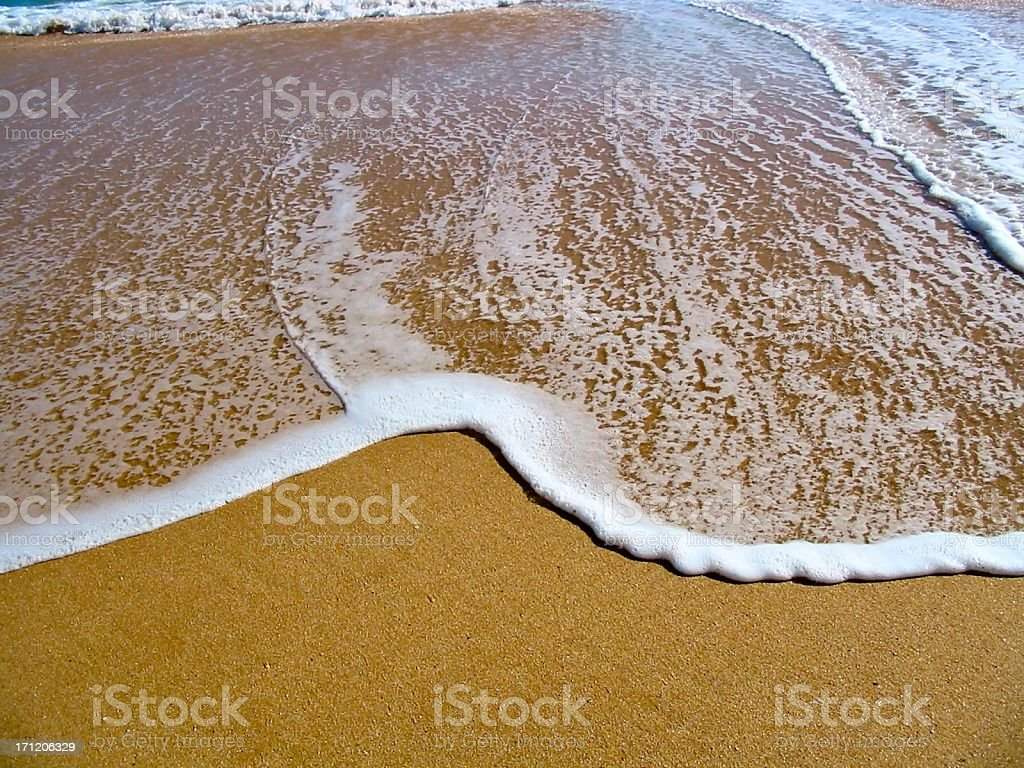 A water wave washed to the shore royalty-free stock photo