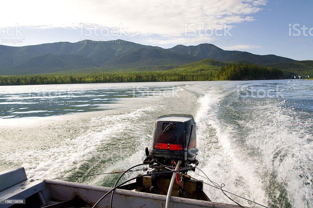 water waves behind motorboat stock photo