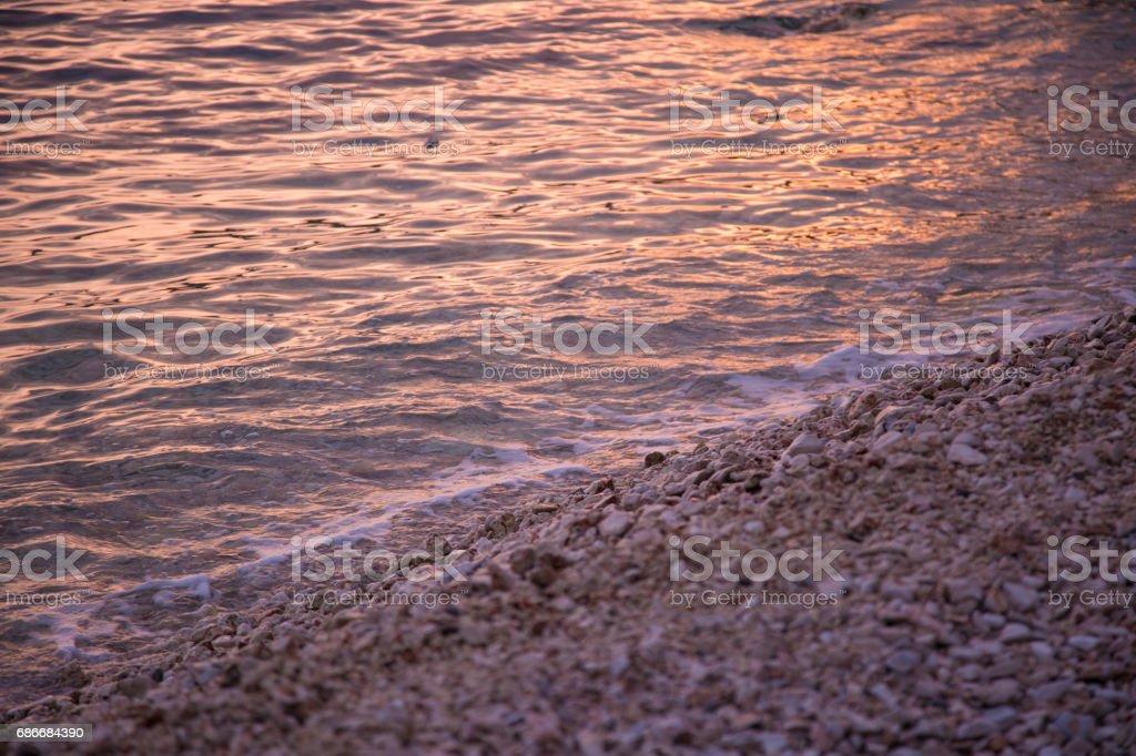 Water waves on sunset stock photo