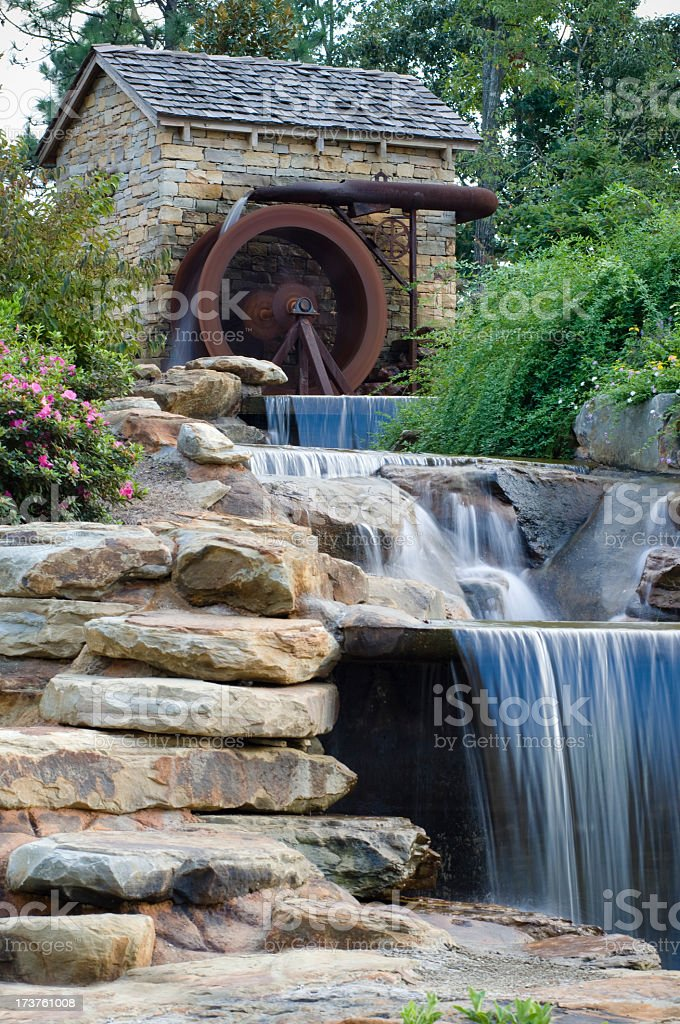 Water Wheel Mill on Bounding  Creek in Landscaping royalty-free stock photo