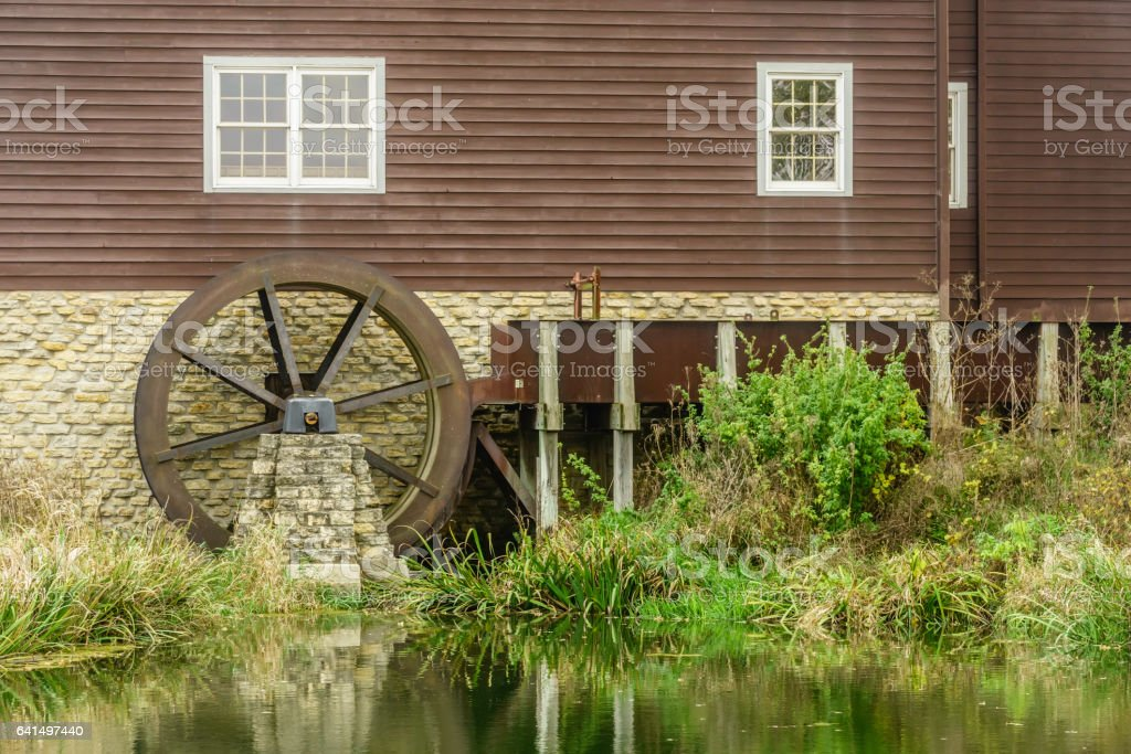 Water wheel of historic grist mill stock photo