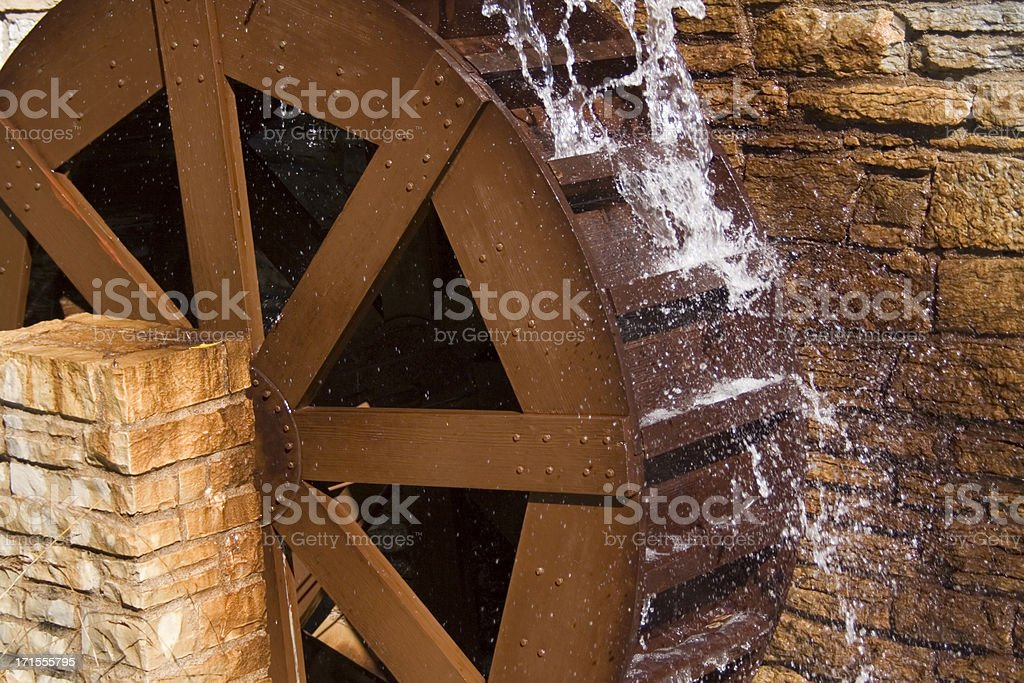 Water Wheel or Watermill Turbine Grinding, Turning, and Generating Power stock photo