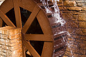 Water Wheel or Watermill Turbine Grinding, Turning, and Generating Power