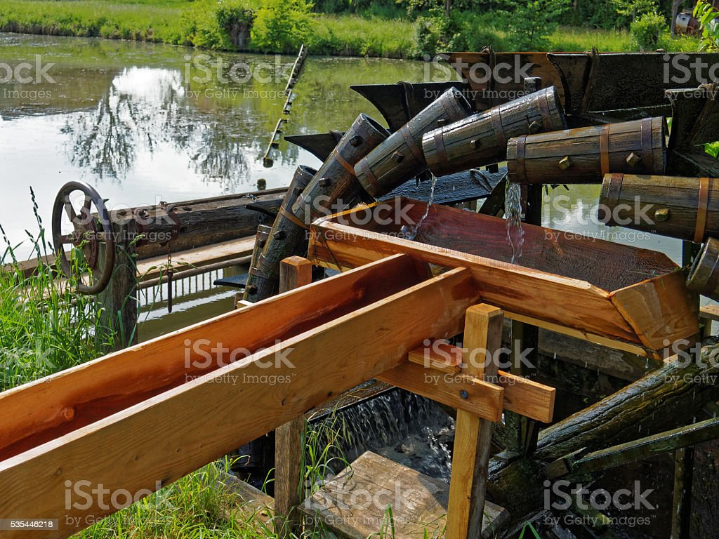 water wheel with wooden jugs stock photo