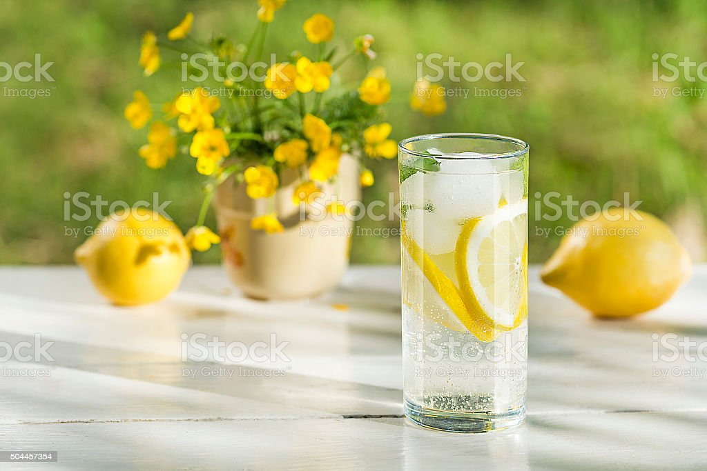 Water with ice and lemon stock photo