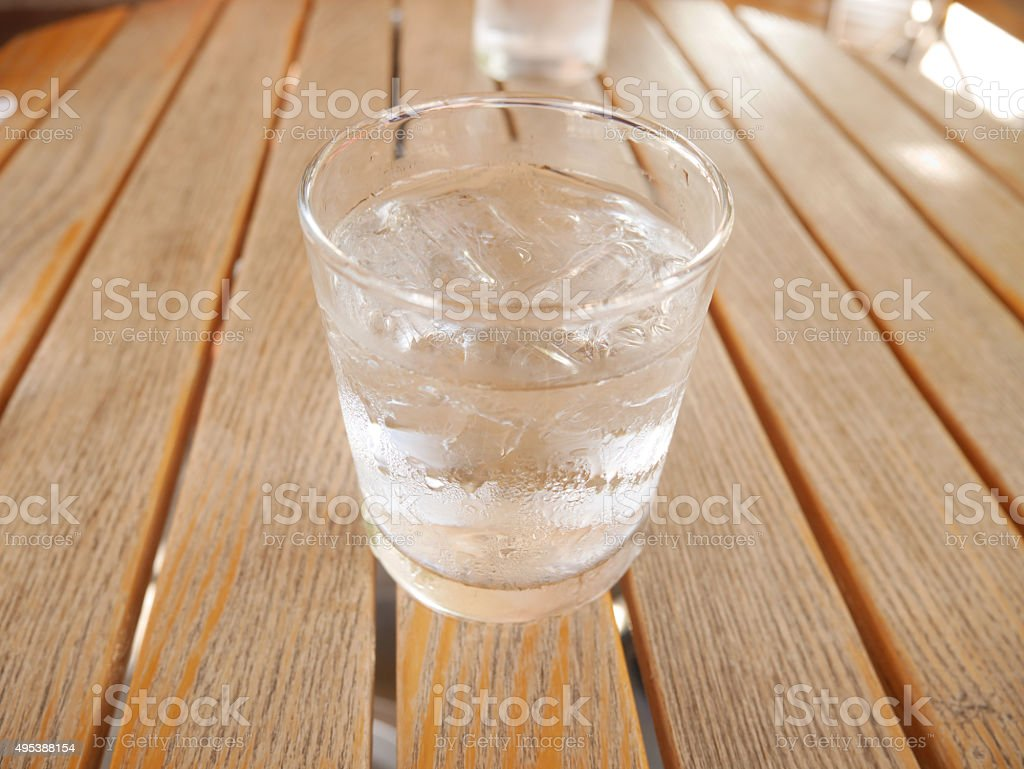 Water with ice cube in a glass stock photo