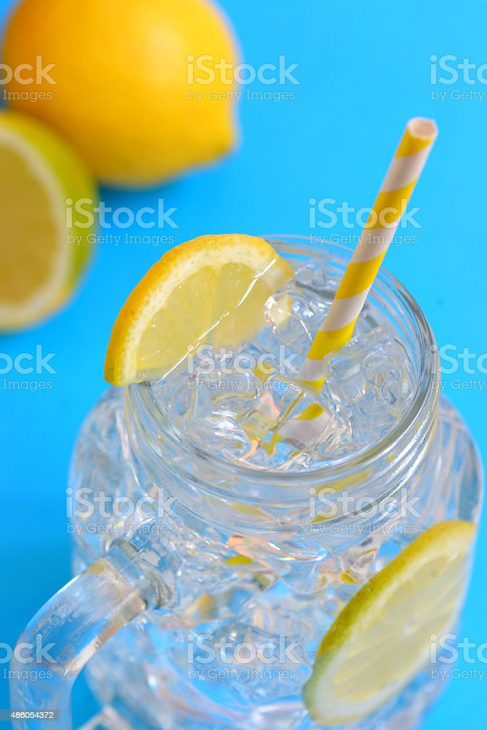 water with lemons stock photo