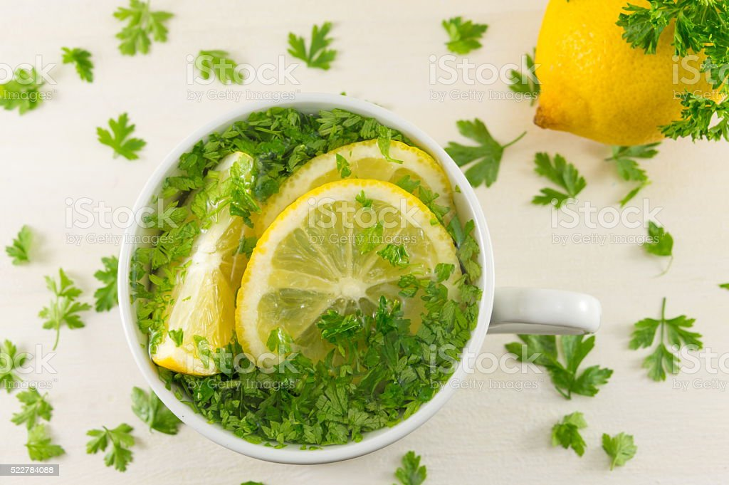Water with parsley and lemon stock photo