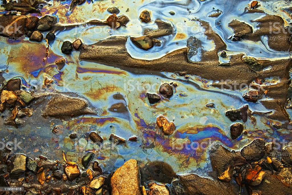 water with  patches of gasoline and oil royalty-free stock photo