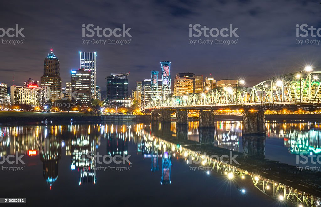 water with reflection and cityscape and skyline of portland stock photo