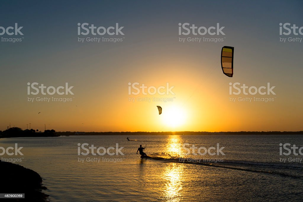 Waterboarding at sunset stock photo